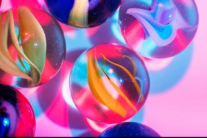 selective focus photography of assorted color marble toys