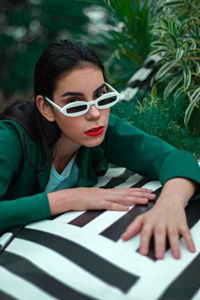 photo of woman wearing white sunglasses
