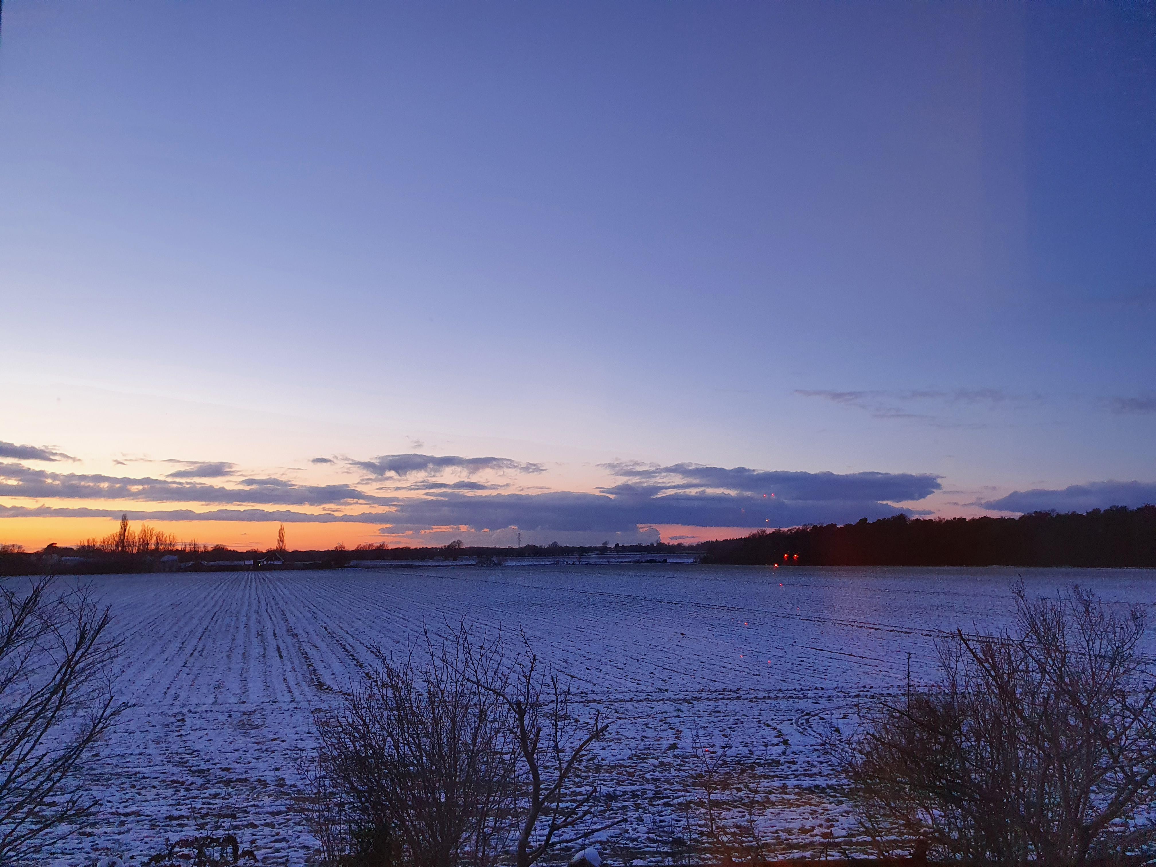 A snowy horizon at dusk